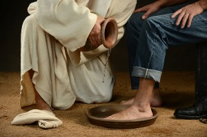 humility bigstock-Jesus-washing-feet-of-modern-m-53037862