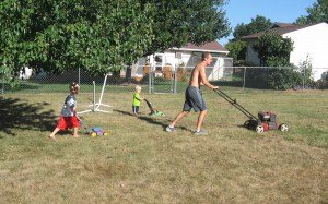 like father - Joel, Asher, and Eli Mowing. (c) 2014 Lambchow.com