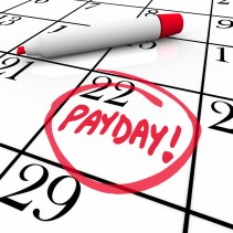 deserve - The word Payday circled in red marker on a calendar to remind yo