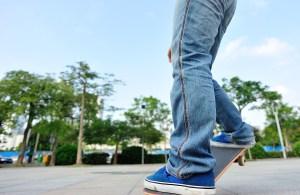 skateboarder legs skateboarding at city
