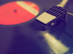 close up vintage turntable with record