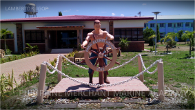 Alumni house statue. A statue of a seafarer holding the wheel stands in front of the PMMA Alumni House.