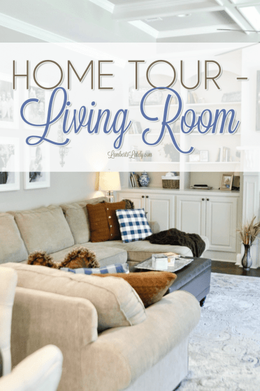 This living room home tour shows the details of this farmhouse-inspired space, including a sectional couch, ottoman/coffee table, rugs, chairs, and pillows.  There are even organization ideas for toys!