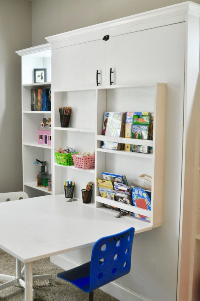 This DIY murphy bed with desk and bookcase combo is all made from inexpensive pieces! Includes Ikea Billy Bookcases and full plans for adding to your guest bedroom, office, or craft room.