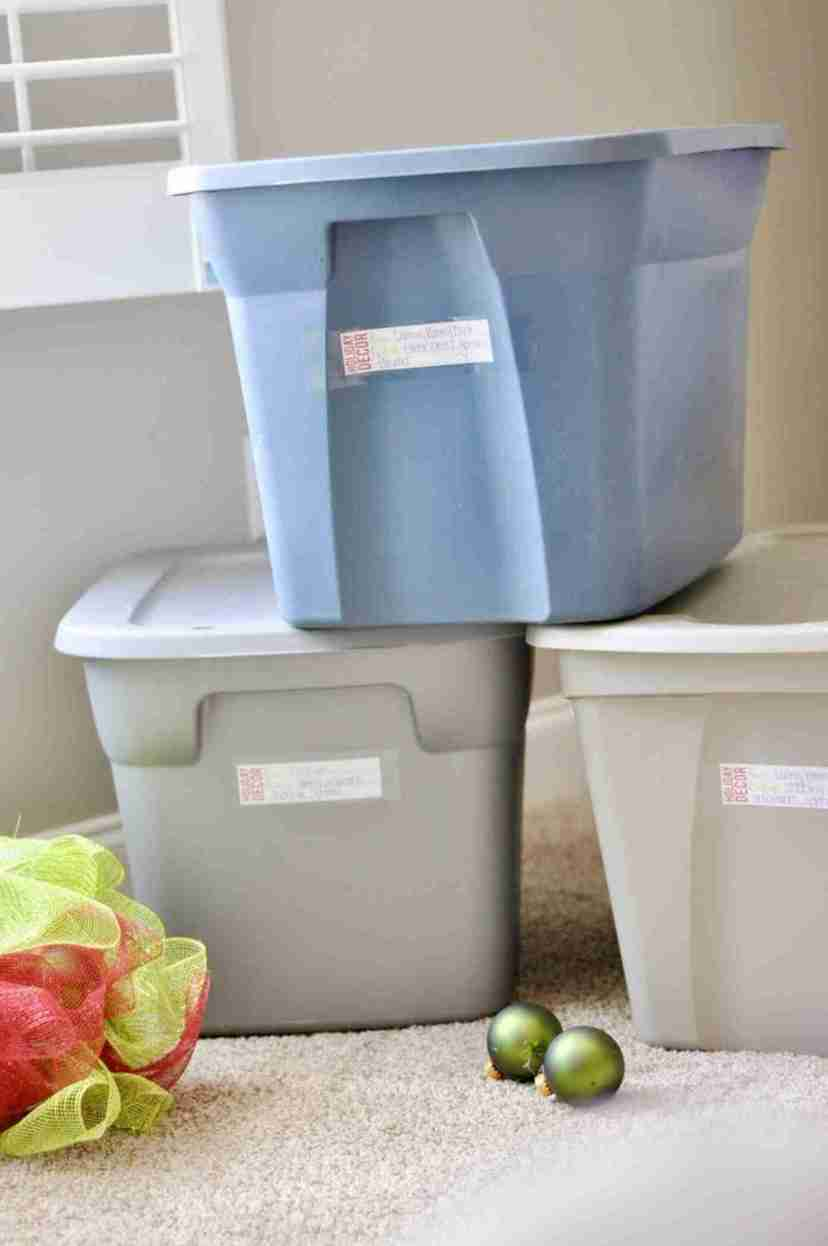 Check out how to organize Christmas storage bins and grab a free printable for your holiday storage boxes! Lots of organization tips and tricks on ways to store Christmas decorations.