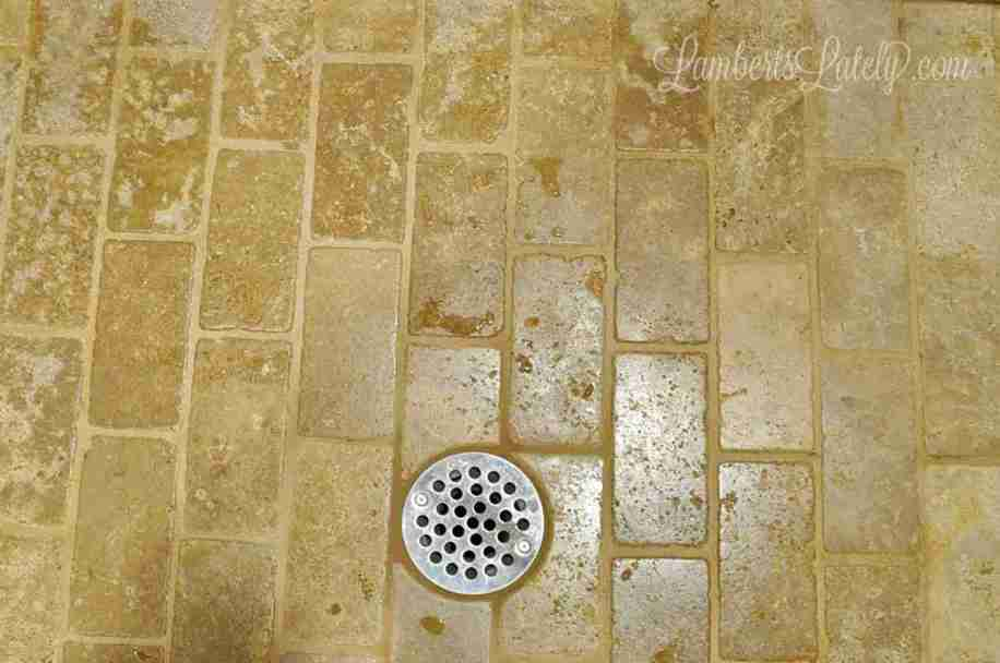 This post looks at a few of the popular ways to clean grout (baking soda and vinegar, bleach toilet bowl cleaner, and boiling water) to see which one really works best. Learn how to clean grout the effective way!