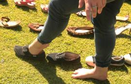 Wits Vuvuzela's Roxanne Joseph opted to go barefoot for the rest of the day after donating her shoes. Photo: Lameez Omarjee