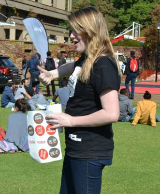 Joanne Tomlinson of the Wits CCO encourages students to donate shoes for the drive. Photo: Lameez Omarjee