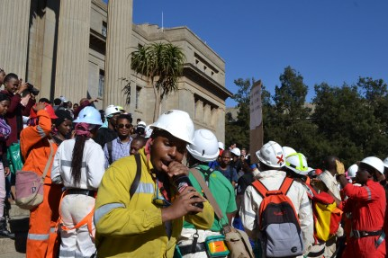 THIRSTY?: Witsies reenact mining drinking culture with water-filled bottles. Photo: Lameez Omarjee