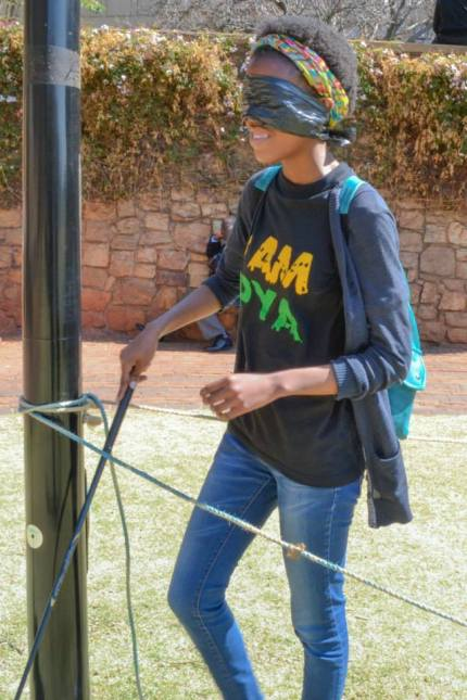 MIND THE POLE: Walking blindfolded was hard to adjust to without any help, for Prisca Thobejane 3rd year BSc. Photo: Lameez Omarjee