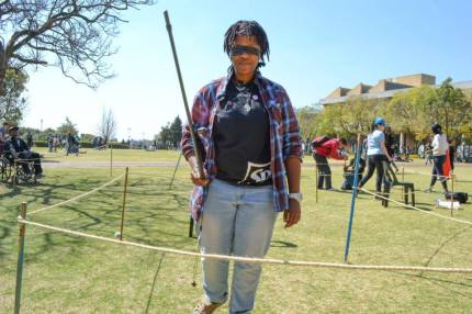 """WALK THE LINE: Having to adapt to her surroundings, Lesedi Tshounyane, 3rd year MBBCH, swung her cane a few times. She said her experience was """"awkward"""". Photo: Lameez Omarjee"""