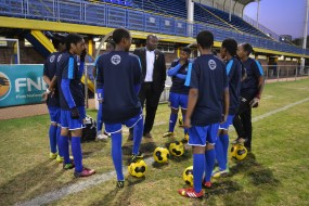 PEP TALK: Before the match against Midrand Graduate Institute starts, coach Dennis Tshablala tells his team to put on a show for the spectators. Photo: Lameez Omarjee