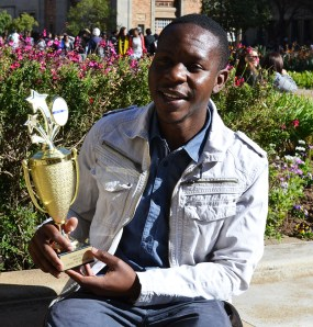BRIGHT STAR: Arthur Motolla, 1st year BA student, from AIESEC Wits with the Rising Star trophy. Photo: Lameez Omarjee