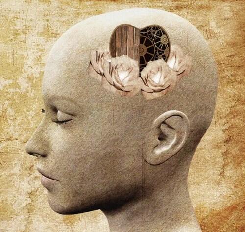 Cabeza de mujer con corazón y mecanismo de pensar