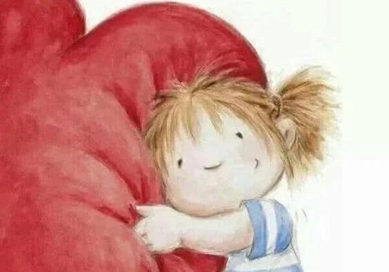niña abrazando corazón