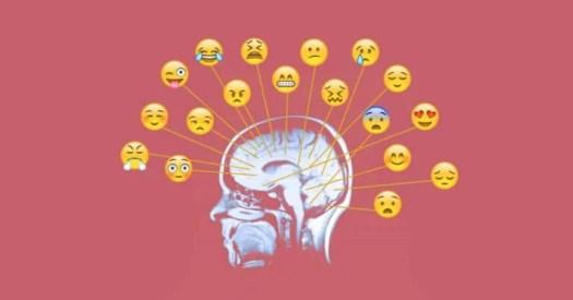 Emoticonos de diferentes emociones señalados en el cerebro de una persona