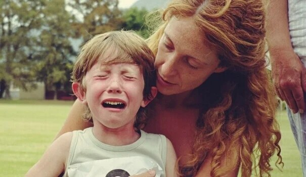 Child crying with his mother