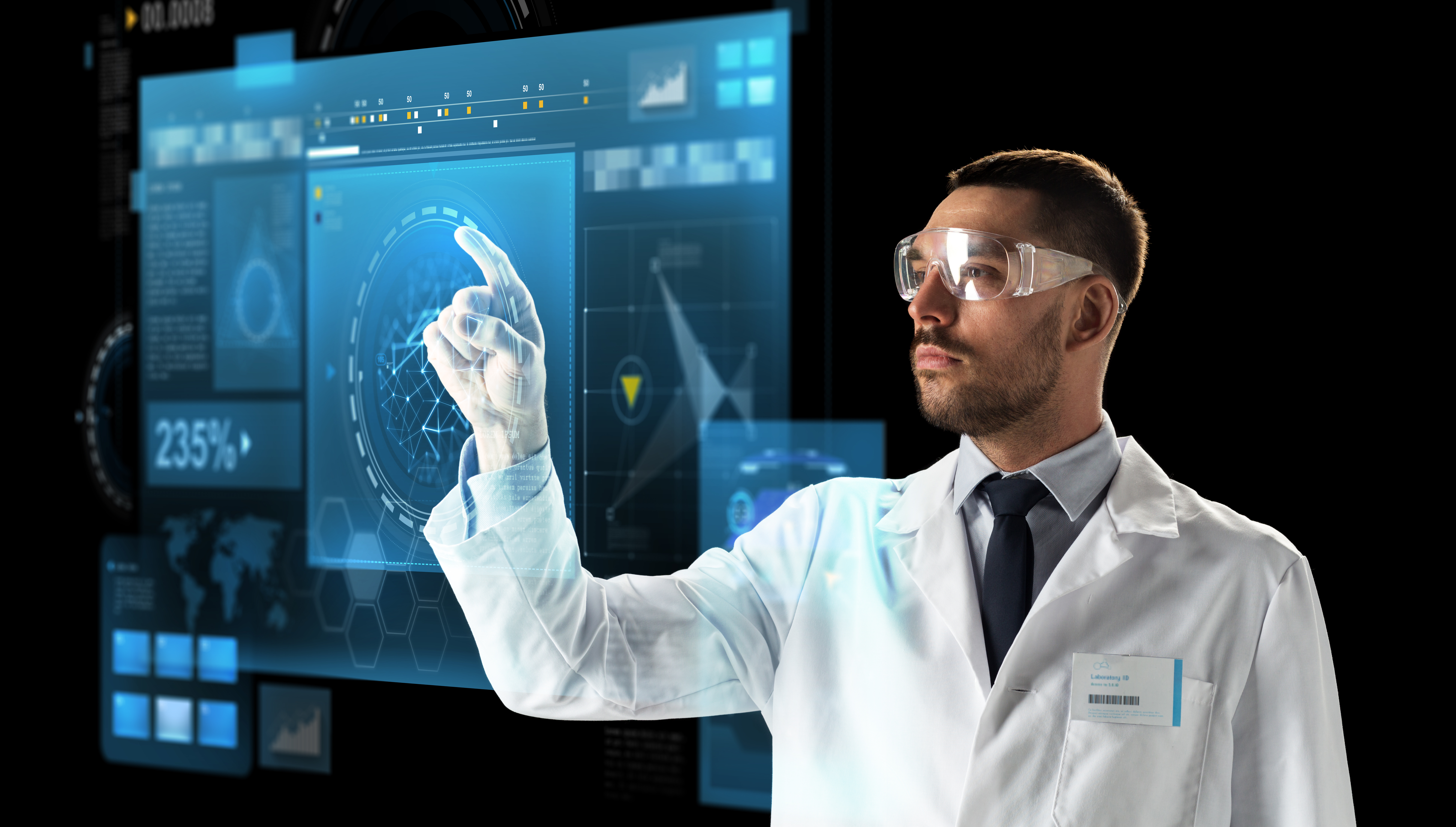 science, future technology and people concept - male doctor or scientist in white coat and safety glasses touching virtual screen over black background