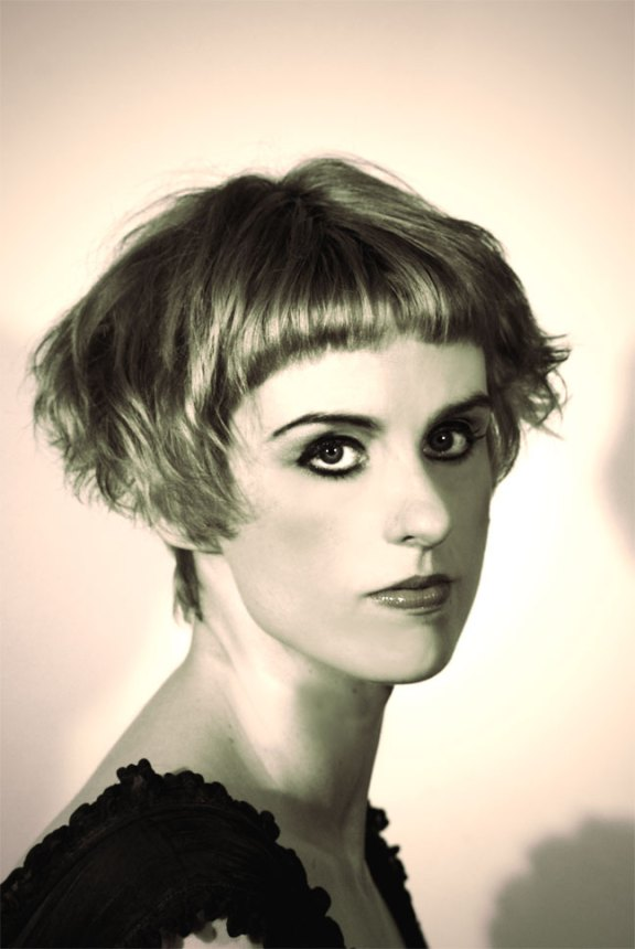 Medium Short Hairstyle With Bangs