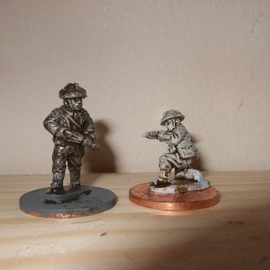 2 figures with sten, 1 advancing other kneeling firing