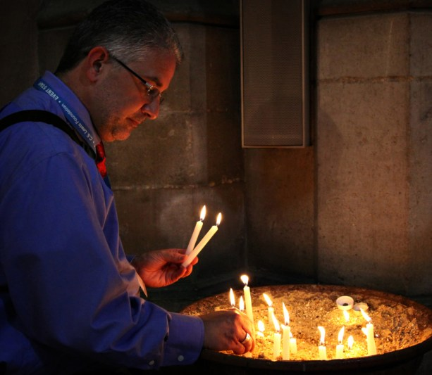 Andrew Lazo lighting candles in Ely Cathedral - Image (c) Lancia E.Smith