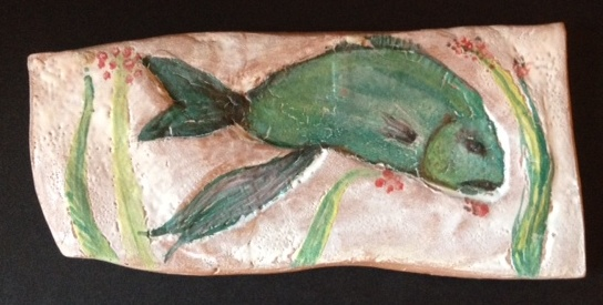 Green fish using maiolica technique.