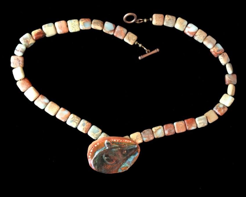 Hyena ceramic necklace.