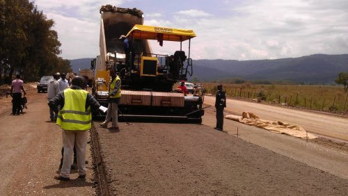 west africa Nigeria ghana road infrastructure under construction with a caterpillar heavy equipment