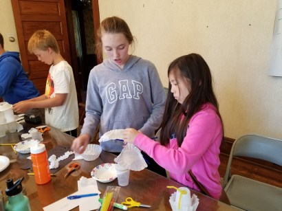 Students use coffee filters for fan blades in their model.