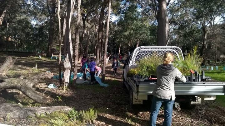 children planting seedlings in Federation Park, Serpentine