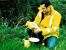 Image shows a technician carrying out landfill gas monitoring.