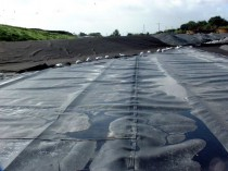An HDPE Landfill Liner Being Constructed on the Base of a Landfill