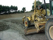 Grader Levelling the Base of a Landfill Before a Liner is  Laid or Any Waste is Placed