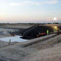 A Landfill cell being geomembrane lined.