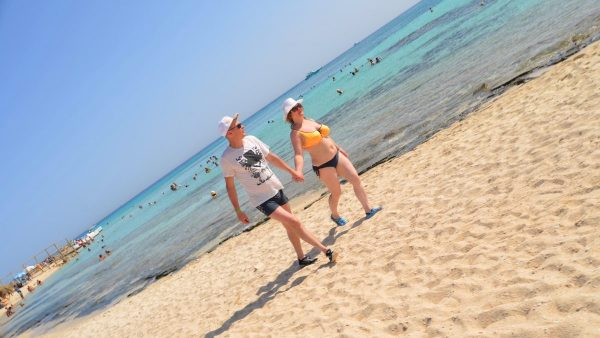 Tourists walk on the beach of Giftun Island in Hurghada