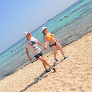 Tourists walk on the beach of Giftun Island in Hurghada