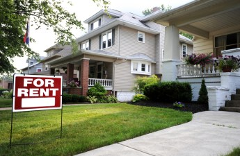 suburban-house-with-red-for-rent-sign-on-lawn