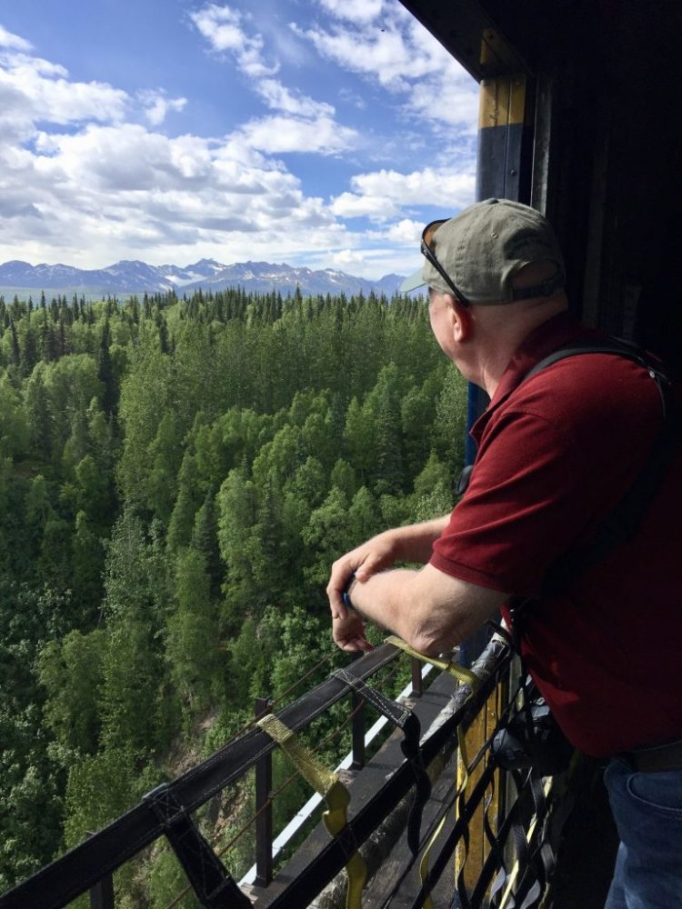 Watching for wildlife in the baggage car