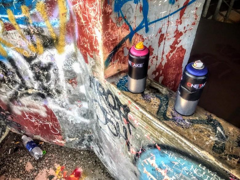 Graffiti cans in Hue's abandoned waterpark, Vietnam