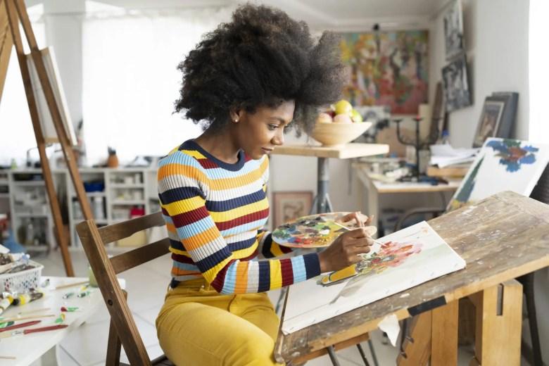 Fine art painter drawing in studio