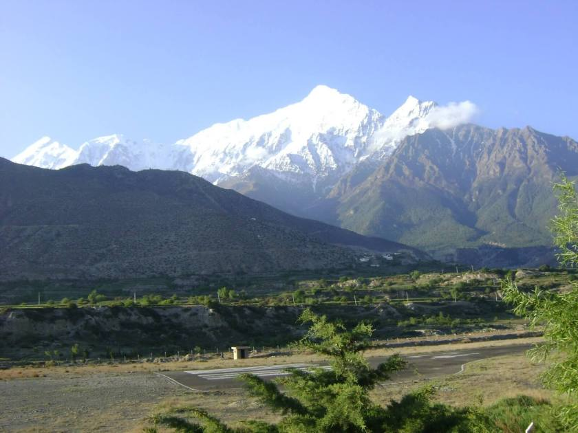 An image showing the air strip in Jhomsom with the mountain range in the background