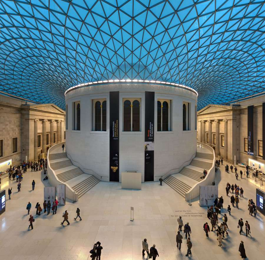 A picturesque view of the British Museum during a busy day.