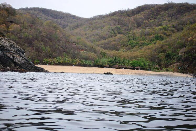 An image taken from aboard a boat of Playa Boquilla. A quiet beach on the Oaxacan coast
