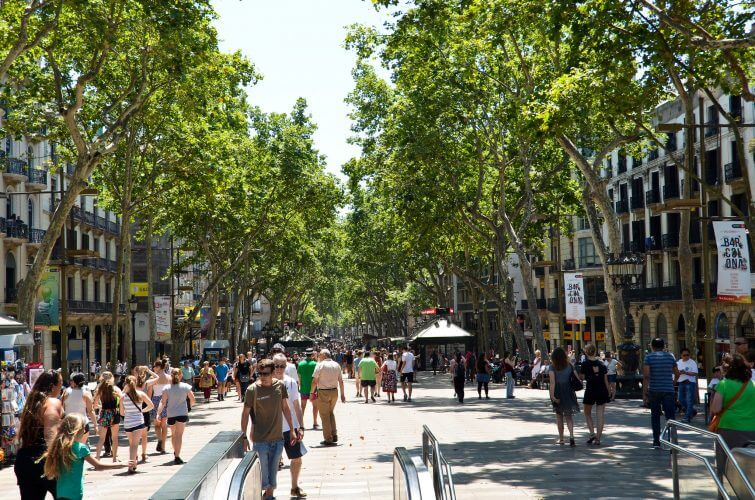 A picture of Las Ramblas boulevard during the day. Home to many artists, street performers and restaurants.