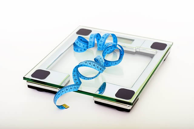 A traditional weight scale is shown here to point out the advantage of a digital luggage scale