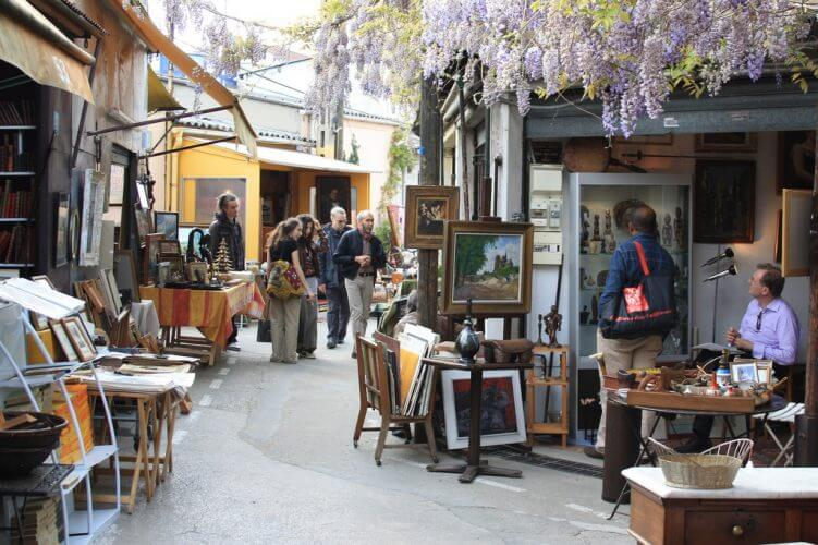A market at Les-Puces-de-Saint-Ouen is shown here