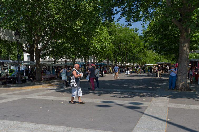The farmers market in Paris during the day is shown here