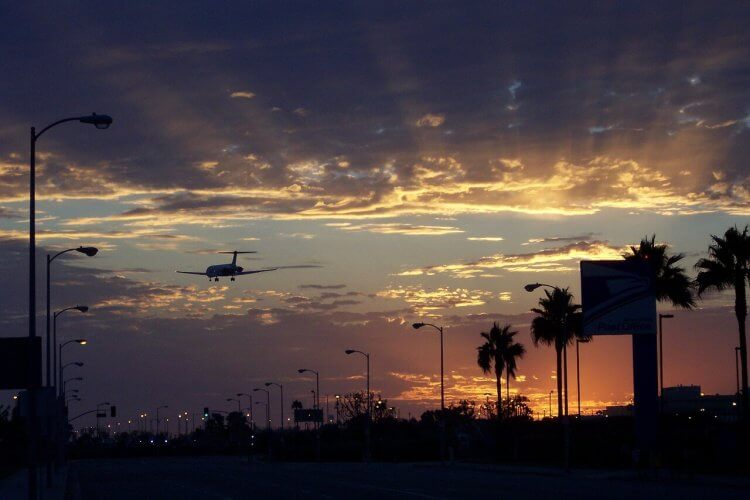 An image of a plane landing at LAX