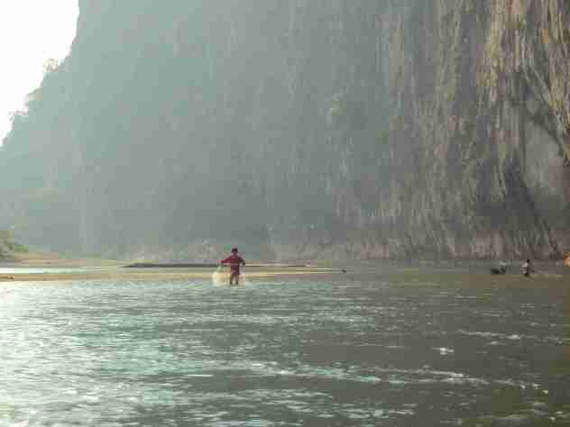 Fischer am Ufer
