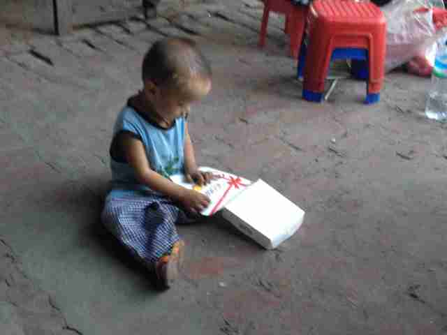 Child playing with box